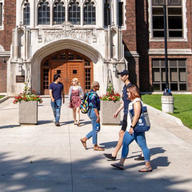 Students walking in front of Dillon Hall