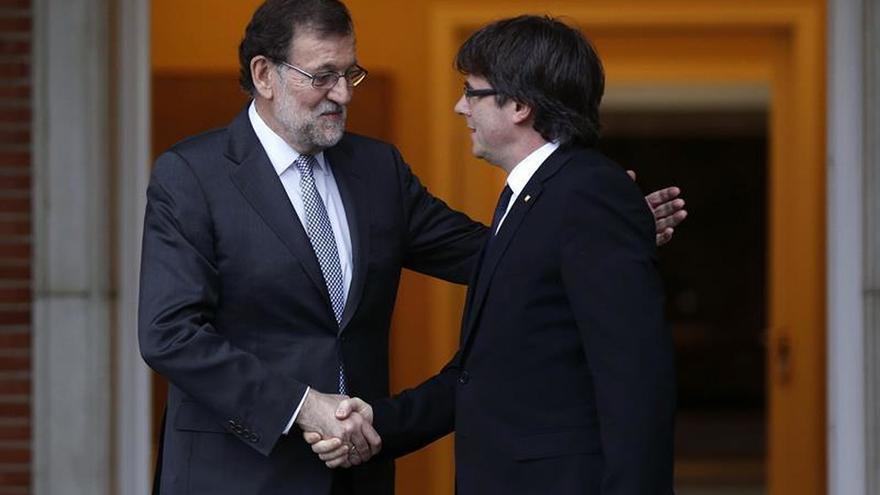 Rajoy y Puigdemont en el pasado. Imagen de archivo. EFE