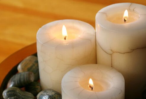 A set of burning scented candles.