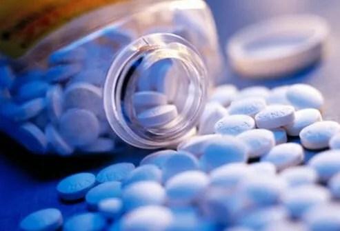 An open bottle of aspirin.