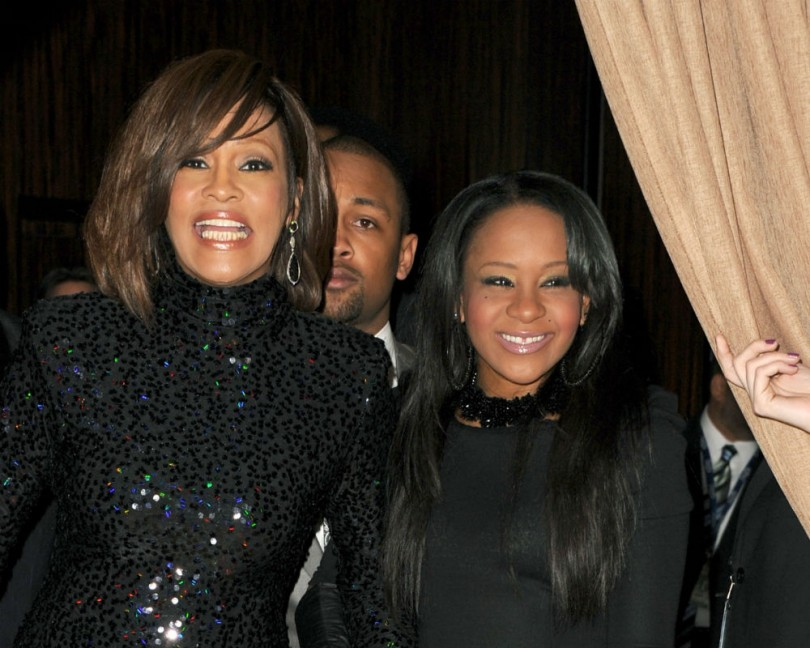 Image result for Whitney, Bobbi and Nick in a family photo