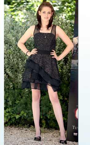 June Gloom  Looks like this goth girl found her perfect cocktail dress. This black tweed J.Mendel frock for a Rome photo call is a li'l gloomy but pretty, just the way Kristen Stewart prefers it. The babe looks more polished than ever, and we like it!