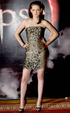 Silver Bullet  We're getting more and more excited for this week's big Eclipse's premiere (we'll be live-streaming!)—even if Kristen Stewart is kinda killing our Twibuzz. Stew goes with another leg-baring strapless minidress in Sweden, this time by Oscar de la Renta. It's cute and all but we can only take so many more of these minis.