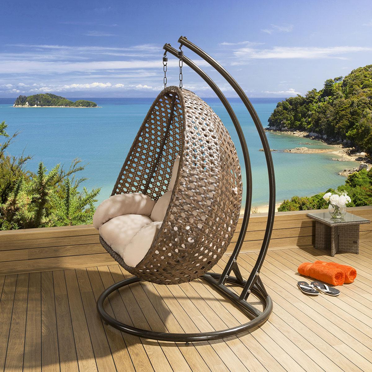 outside hanging chair uk folding outdoor chairs walmart 2 person garden brown rattan cream