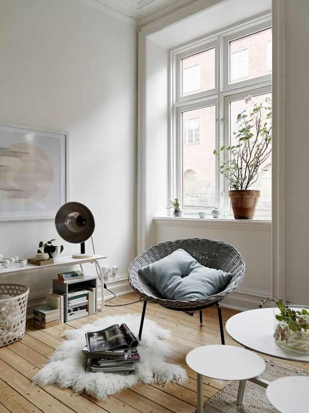 Interiores de un monoambiente nrdico con mucho estilo