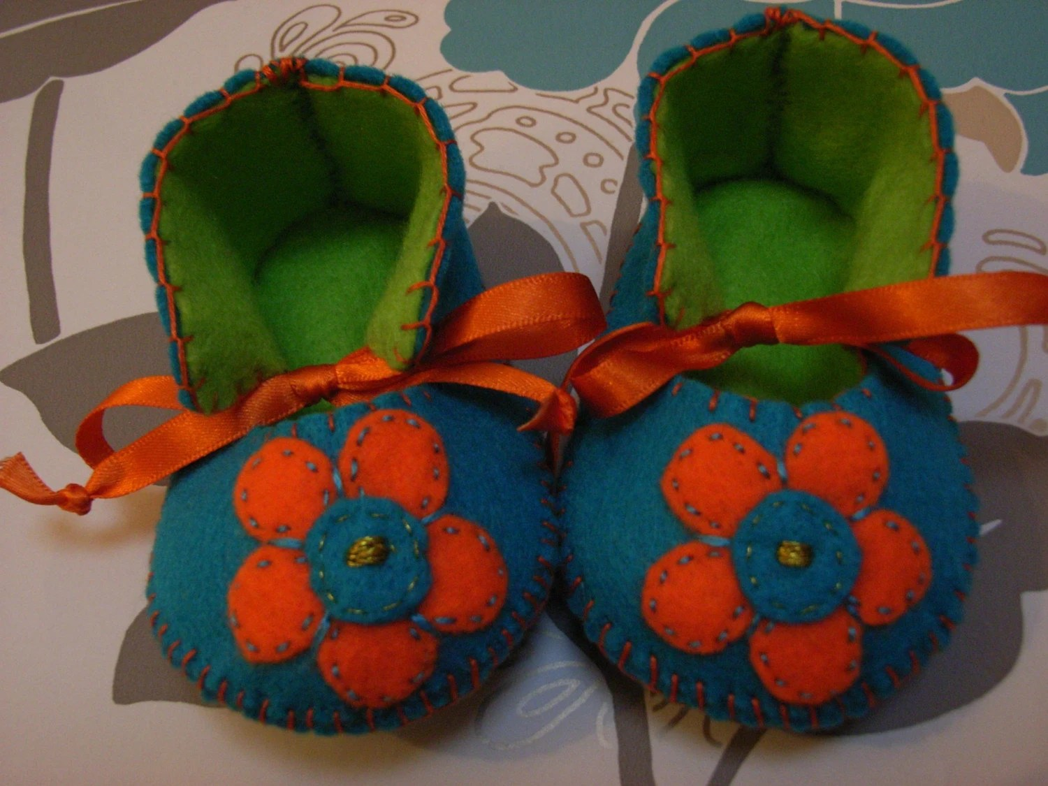 BEAUTIFUL AND UNIQUE TURQUOISE AND LIME BABY BOOTIES WITH FLOWERS ON THEIR FRONT-HAND STITCHED