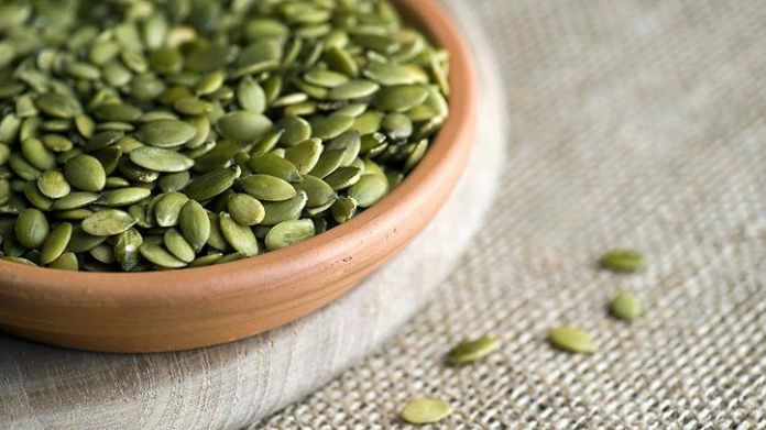 a bowl of pumpkin seeds which are high in magnesium
