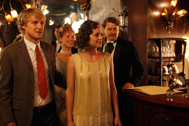 "Owen Wilson as Gil and Marion Cotillard as Adriana in ""Midnight in Paris."""