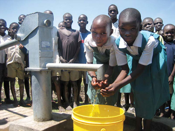 A working pump can make all the difference, as it does for these schoolgirls in Kisumu, Kenya. The pump was installed by White's original charity, WaterPartners. | Photograph courtesy of Water.org