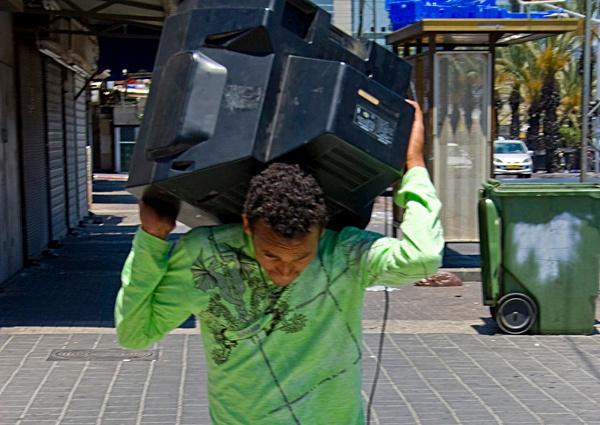 Man Carrying TV