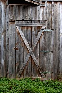 Rustic Old Wooden Barn Door Photograph by Heather Reeder