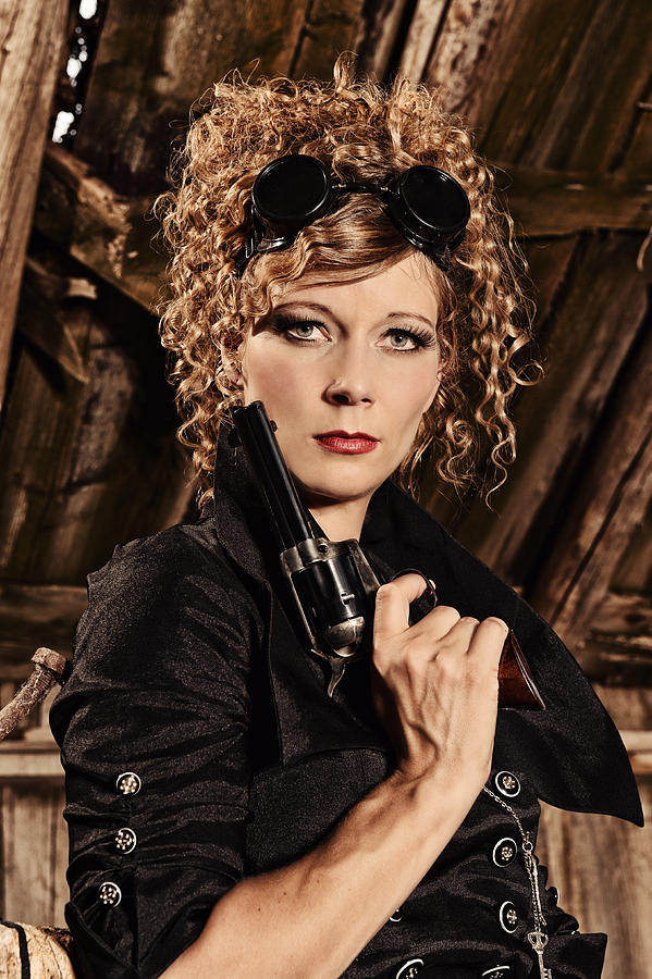 Steampunk Woman With Pistol Goggles And A Lethal Look