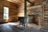 Wood Burning Stove In Cabin Photograph by Cheryl Birkhead