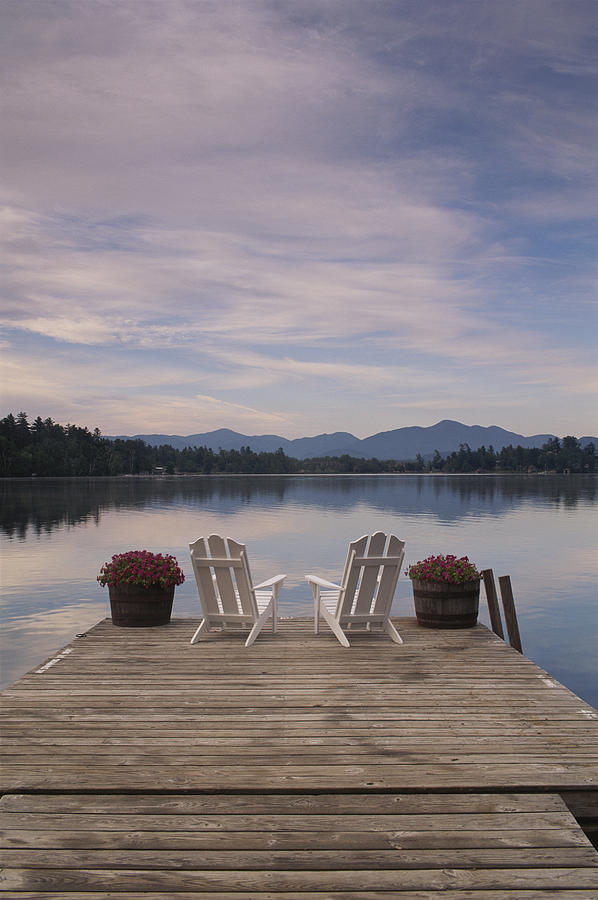 metal adirondack chairs art deco club leather a pair of on dock photograph by michael melford