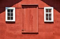 Rustic Red Barn Door With Two White Wood Windows ...