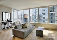 Upscale Living Room In High Rise Condo Photograph by ...
