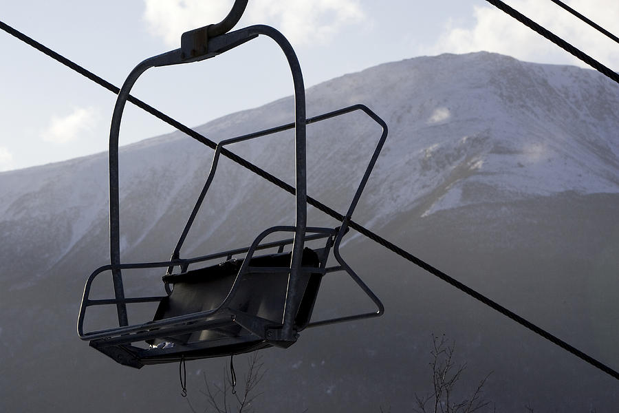 ski chair lift bamboo high back chairs an empty at a resort photograph by tim laman