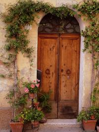 Flowered Tuscan Door Photograph by Donna Corless