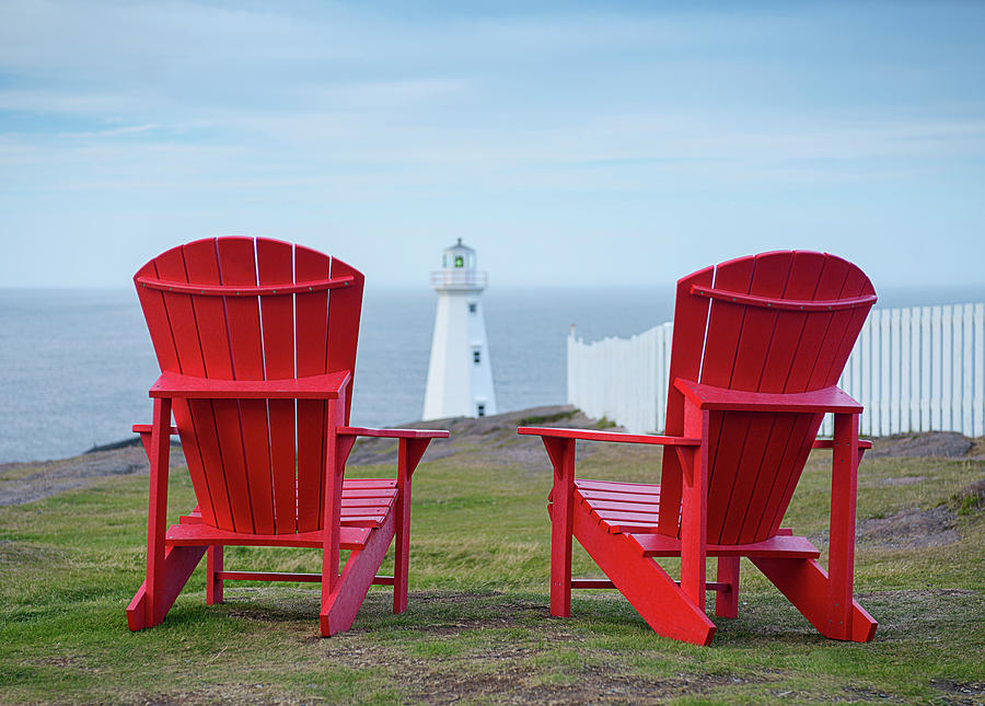 red adirondack chairs chair stand test table two looking out to a lighthouse photograph by art whitton