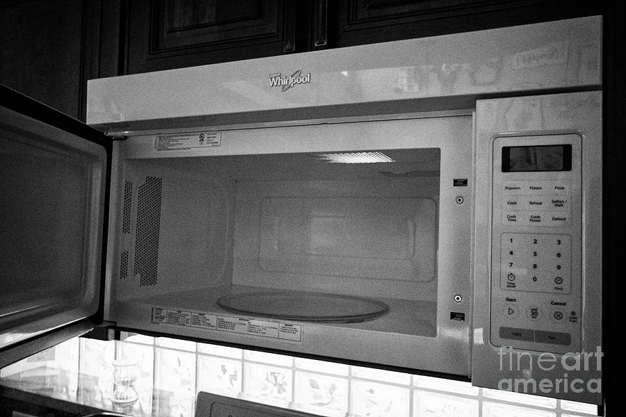 open door of a whirlpool microwave oven in a kitchen in the usa united states of america by joe fox