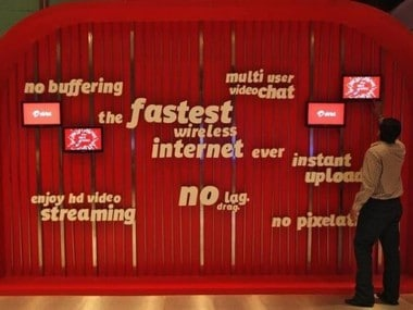 A man touches a screen on a Bharti Airtel advertisement billboard during the launch ceremony for 4G services in Kolkata April 10, 2012. REUTERS/Rupak De Chowdhuri/Files
