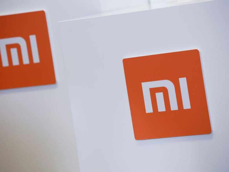 Xiaomi logos are seen during a news conference. Image: Reuters