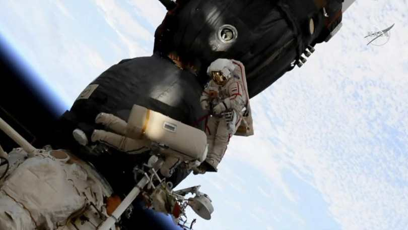 In this still captured on 11 December, 2018  from the video made available by NASA, Russian cosmonaut Oleg Kononenko (right), and Sergei Prokopyev perform a spacewalk outside the Soyuz spacecraft attached to the International Space Station. Prokopyev and Kononenko, who have explored a mysterious hole in a capsule docked to the International Space Station said that Russia's law-enforcement agencies are now investigating its cause. NASA