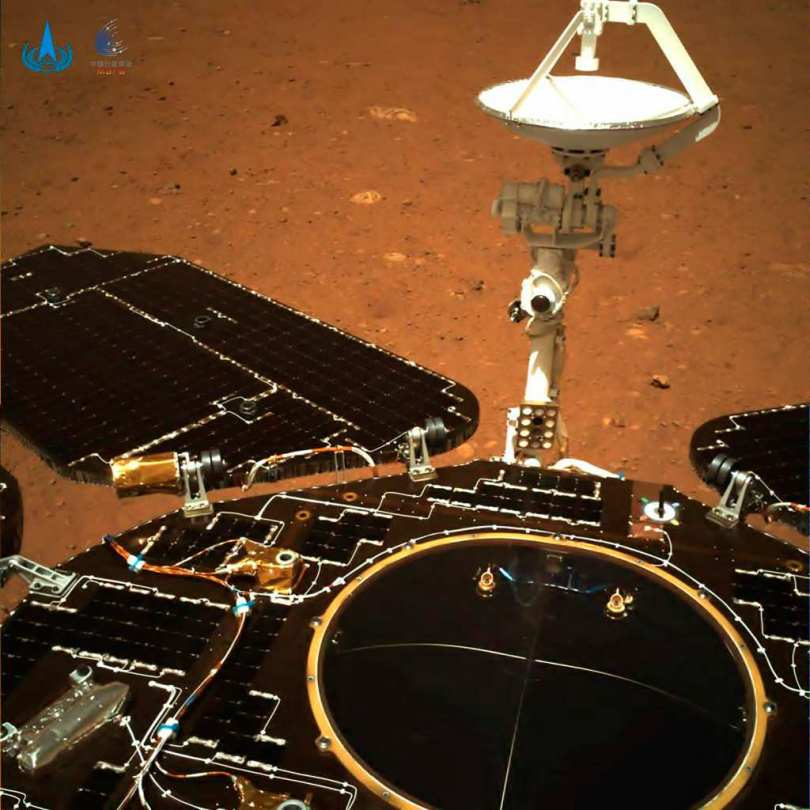 The second image which is a colour photo was taken by the navigation camera that is on the rear of the rover. One can see the solar panels and antenna unfolding along with the red soil and rocks on the Martian surface. Image credit: CNSA via AP