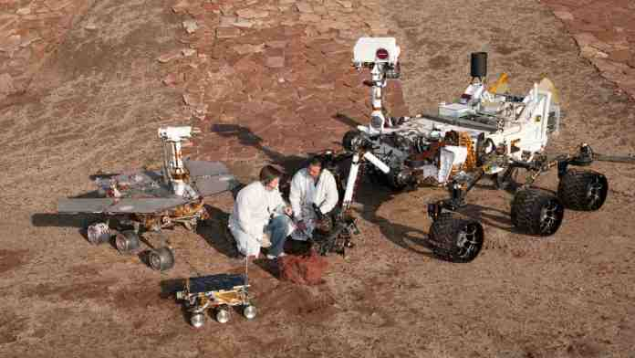 Front and center is the flight spare for the first Mars rover, Sojourner, which landed on Mars in 1997 as part of the Mars Pathfinder Project. On the left is a Mars Exploration Rover Project test rover that is a working sibling to Spirit and Opportunity, which landed on Mars in 2004. On the right is a Mars Science Laboratory test rover the size of that project's Mars rover, Curiosity, which is on course for landing on Mars in August 2012. Missing in frame is Perseverance rover. Image credit: NASA
