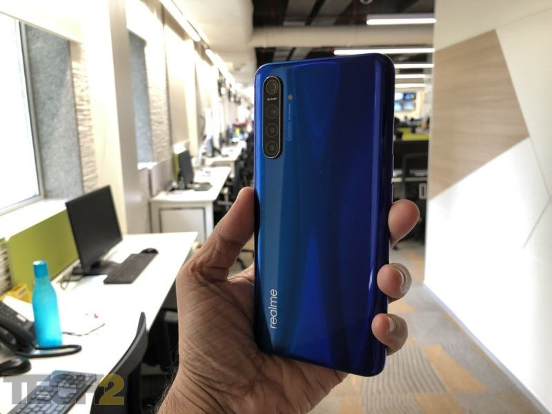 Realme XT is quite the handful with a 6.4-inch display up front and Gorilla Glass 5 protected back and front