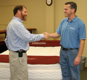 VP Kevin congratulates Dave on making a great mattress