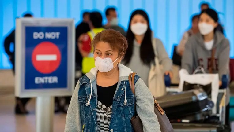COVID-19 cases climb to at least 91 in US as outbreak clusters ...