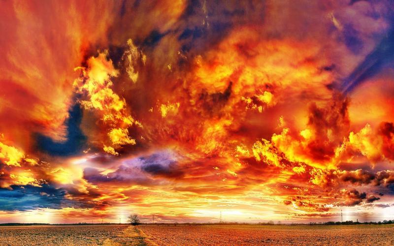 HD Fiery Clouds Over A Sunset Field Wallpaper Download