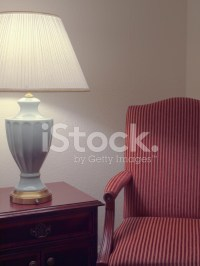 Cozy Corner With Arm Chair and Lamp Stock Photos