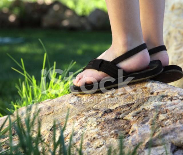 Close Up Of Little Boys Feet On A Rock