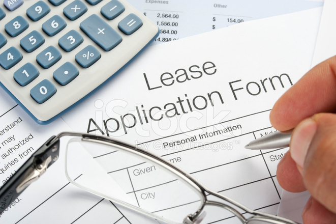 Lease Application Form With Pen, Calculator, Writing Hand Stock ...