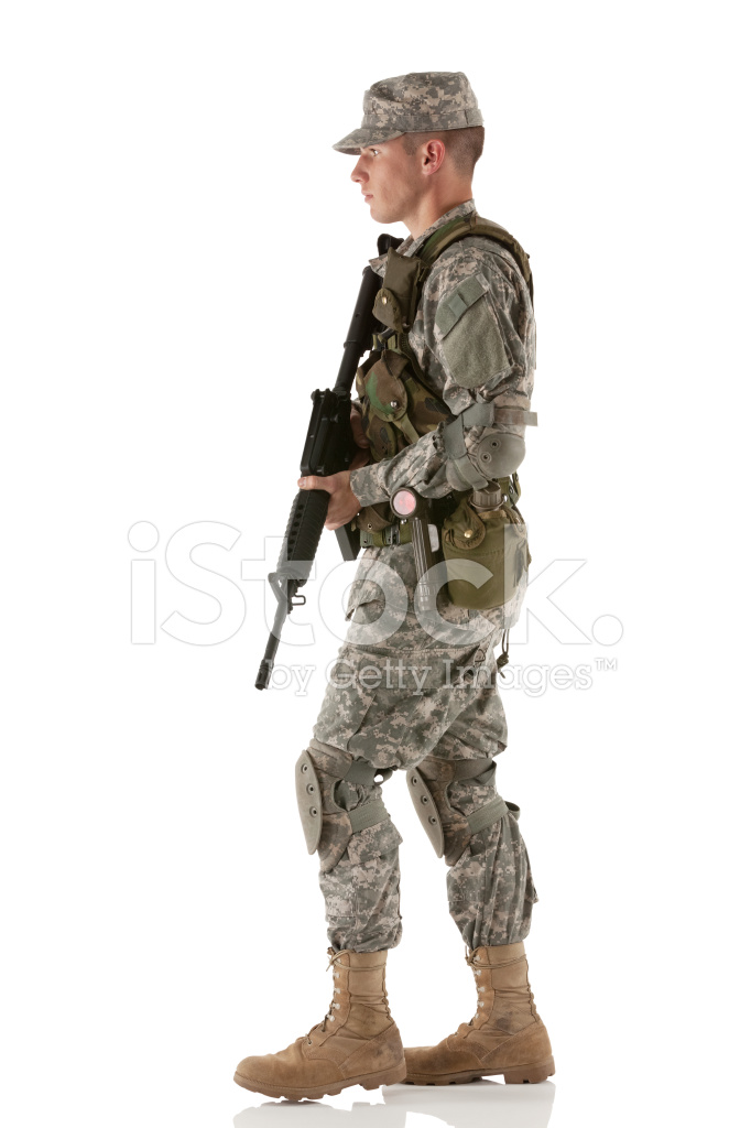 Army Soldier Walking With A Rifle Stock Photos