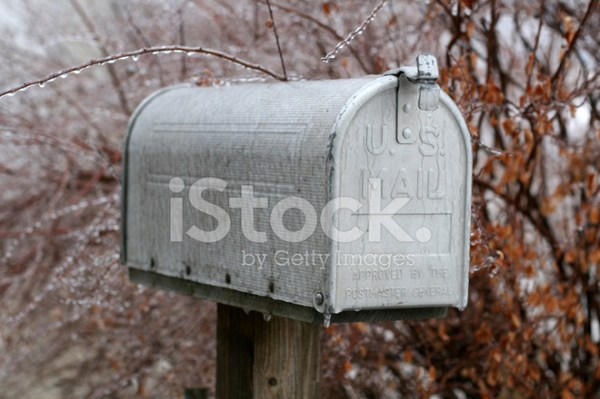 rural weathered mailbox in winter