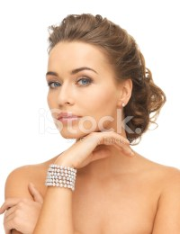Woman With Pearl Earrings and Bracelet Stock Photos