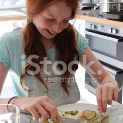 Kitchen Table Round Marble Island 形象的女孩在厨房的桌子吃饭鱼馅饼照片素材 Freeimages Com Premium Stock Photo Of 形象的女孩在厨房的桌子吃饭鱼馅饼