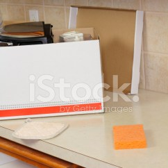 Kitchen Counters Tables For Small Kitchens 打开移动框在厨房柜台上照片素材 Freeimages Com Premium Stock Photo Of 打开移动框在厨房柜台上