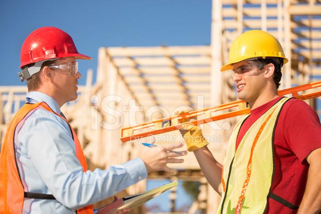 Construction Worker Supervisor Discuss Job AT Work Buildi Stock Photos  FreeImagescom