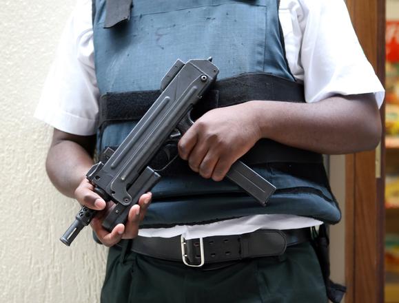 guard-with-machine-gun