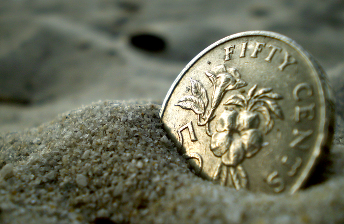 coin-in-sand