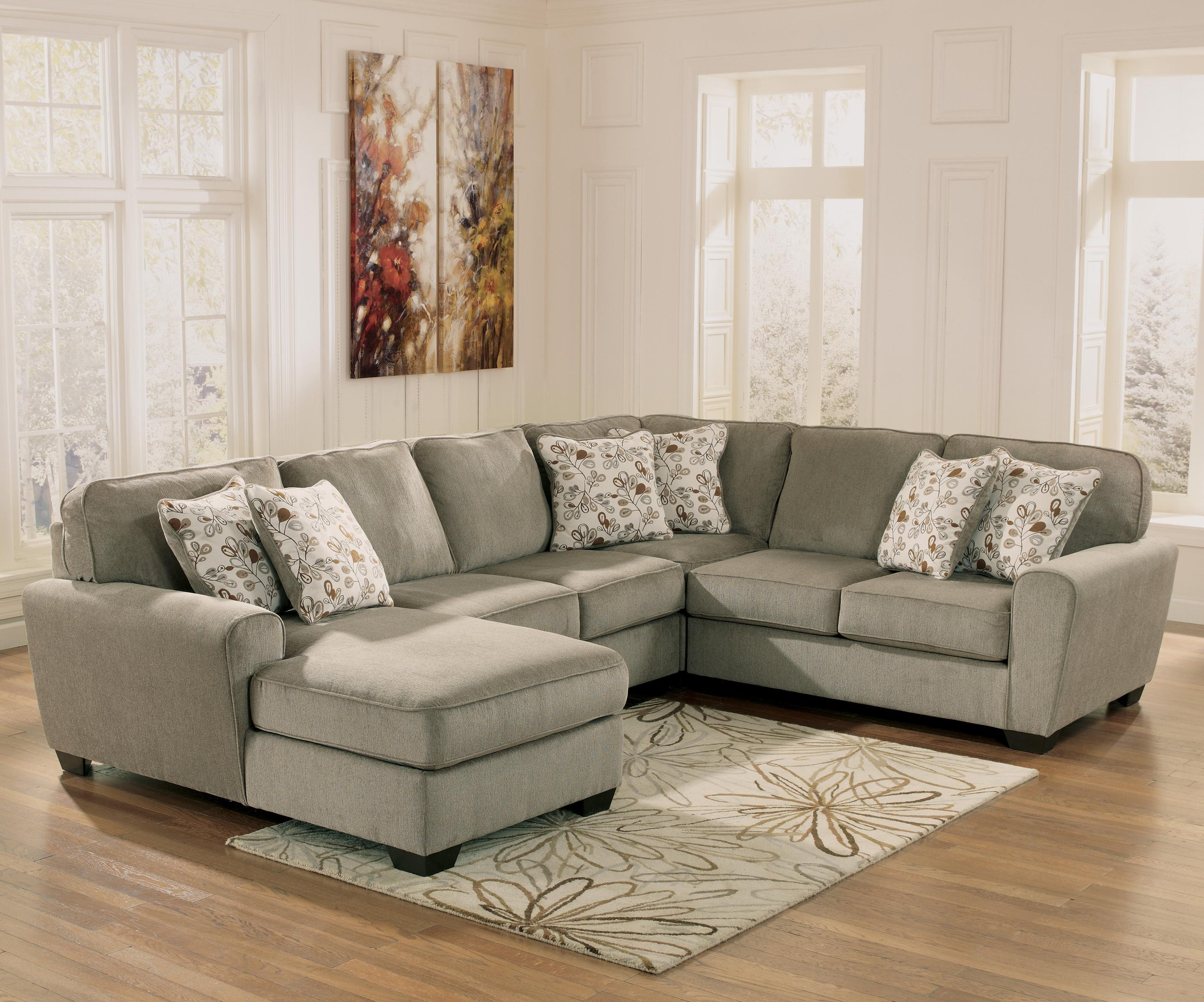 ashley cohes sofa chaise everyday beds uk patina 4 piece small sectional with left rotmans