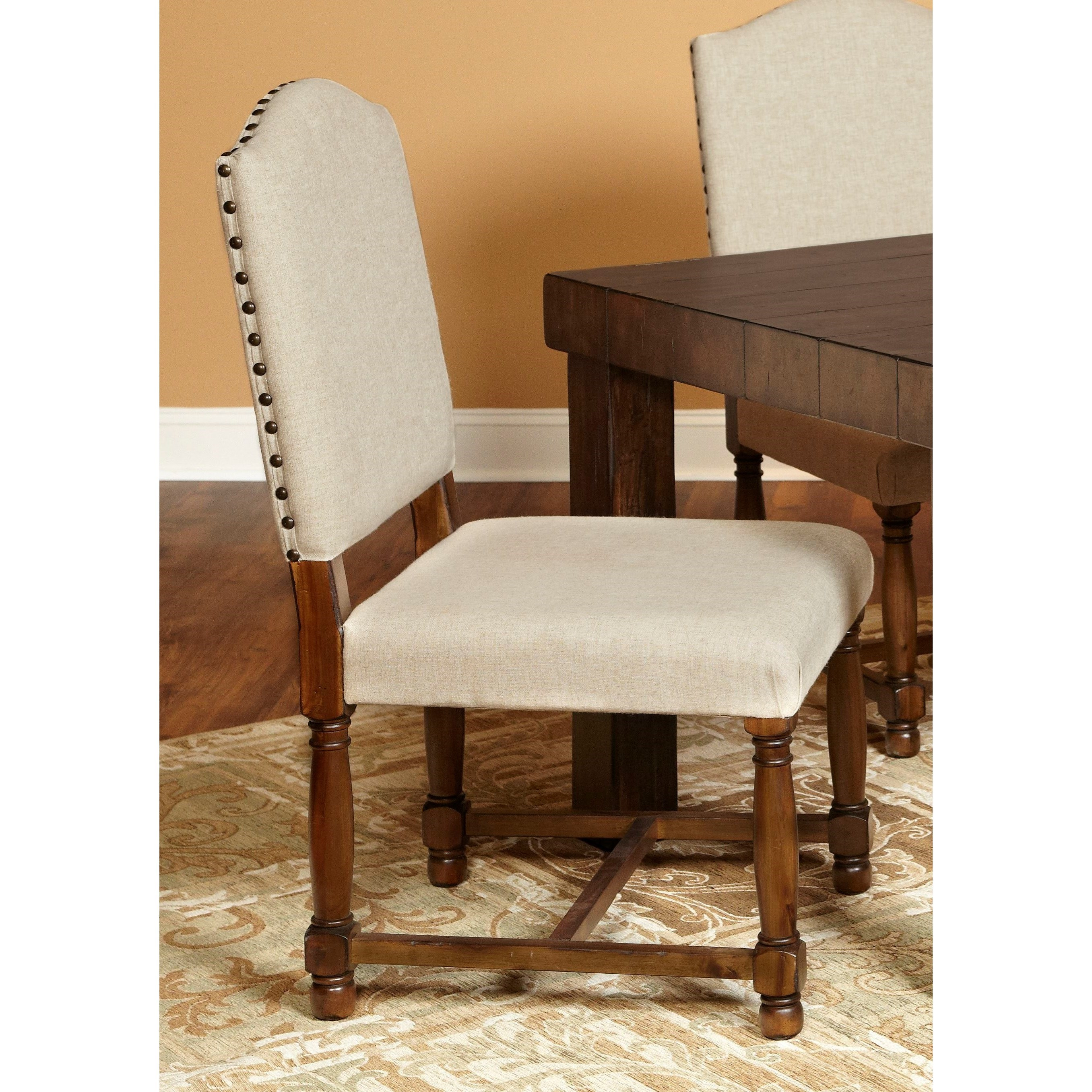 cream upholstered dining chairs stressless chair creaking largo lance side with nailhead