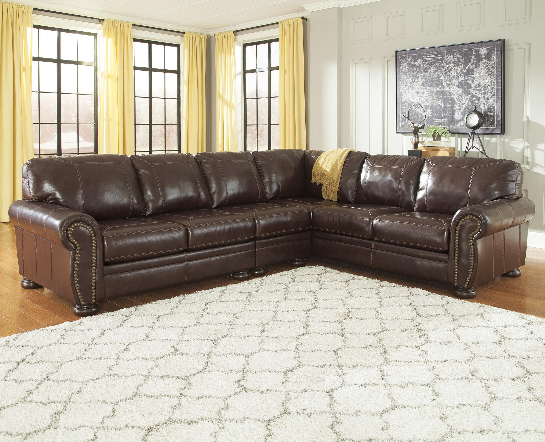 nailhead trim sofa ashley black leather sofas argos signature design by francesco 3 piece match