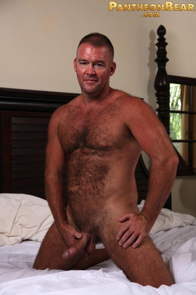 Hairy bear Bruce Mills in a bedroom