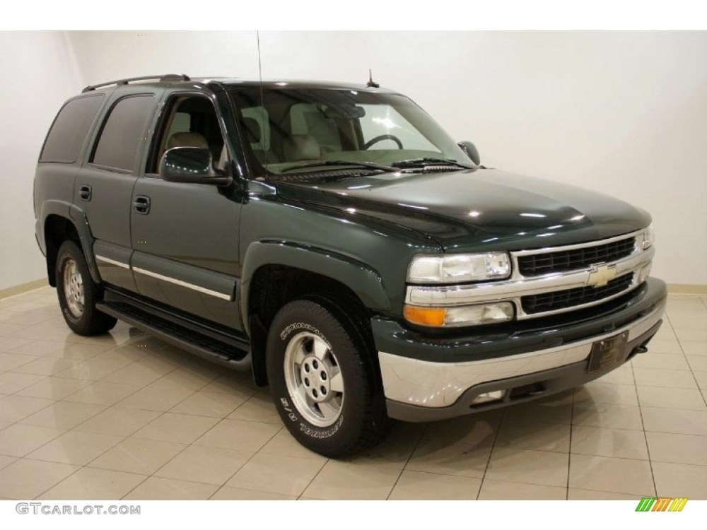 medium resolution of 2003 tahoe lt 4x4 dark green metallic tan neutral photo 1