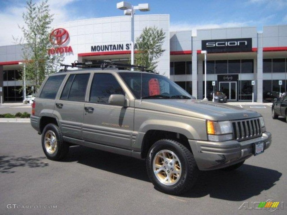 medium resolution of charcoal gold satin jeep grand cherokee 1996